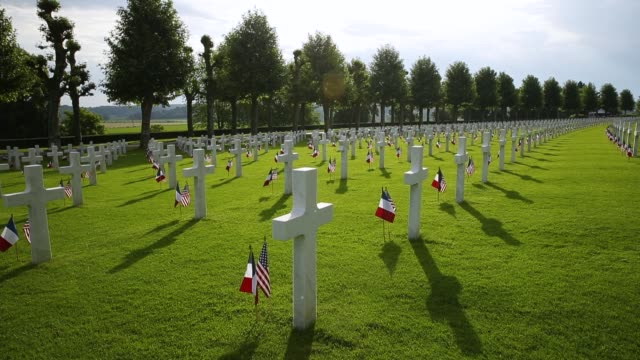 US and French flags flutter at the graves of US soldiers most of them killed in the World War I Battle of Belleau Wood at the AisneMarne American...