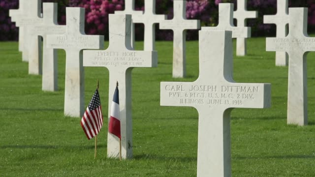 S and French flags stand at one of the many graves of US soldiers most of them killed in the Battle of Belleau Wood at the AisneMarne American...