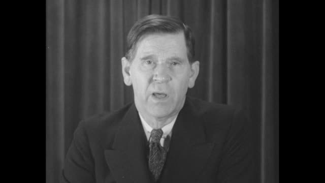 ms and cu headshot man in dark suit speaks in front of black curtain speaking vehemently he might be criticizing pres herbert hoover's plan to fight... - headshot stock videos & royalty-free footage