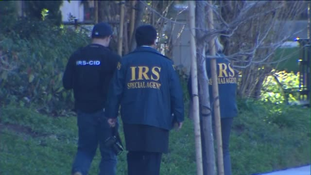and hsi investigate hotel in irvine. federal agents raided 20 locations in three socal counties on march 3rd, 2015 as part of an investigation... - aggression stock videos & royalty-free footage