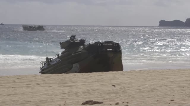 us and international forces together with marine air ground task force unload from assault amphibious vehicles on pyramid rock beach marine corps... - amphibious vehicle stock videos & royalty-free footage