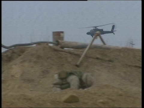 and iraqi military assault on fallujah begins; bbc pool gv us troops settling into positions on outskirts of fallujah ground to air us cobra attack... - アルファルージャ点の映像素材/bロール