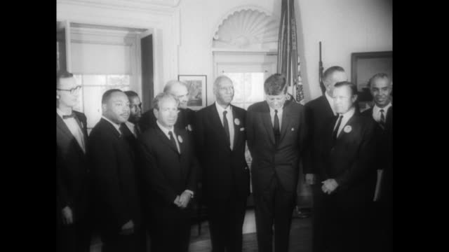 jfk and lbj meet with roy wilkins asa philip randolph mlk walter reuther and others at white house and pose for the press - john f. kennedy politik stock-videos und b-roll-filmmaterial
