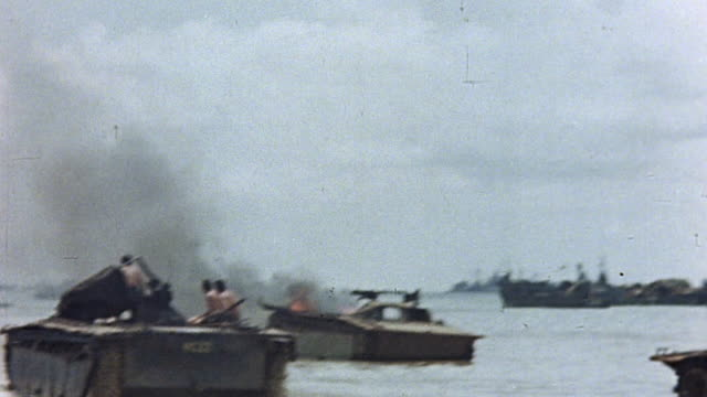 and lcvp crafts circling disabled, burning landing craft off the coast of guam during wwii pacific campaign / mariana islands¬† - guam video stock e b–roll