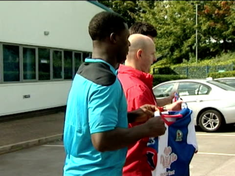 and manager Steve Kean interviews with cutaways of new players holding the team shirt ISNTV Premier League new signings Blackburn new signings Yakubu...