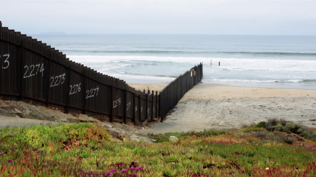 MS, DS, T/L, USA and Mexico border fence on beach, San Diego, California, USA