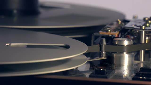 cu and pan of playback mechanism on reel-to-reel tape recorder - bribing stock videos & royalty-free footage