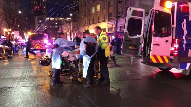 emt and police rush to aid to a shooting victim in downtown on january 22 2020 in seattle washington as many as seven people have been reportedly... - seattle stock videos & royalty-free footage