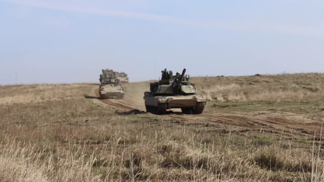 us and polish soldiers conduct a combined arms live fire exercise with abrams tanks and bradley fighting vehicles at drawsko pomorskie training area... - infanteri bildbanksvideor och videomaterial från bakom kulisserna