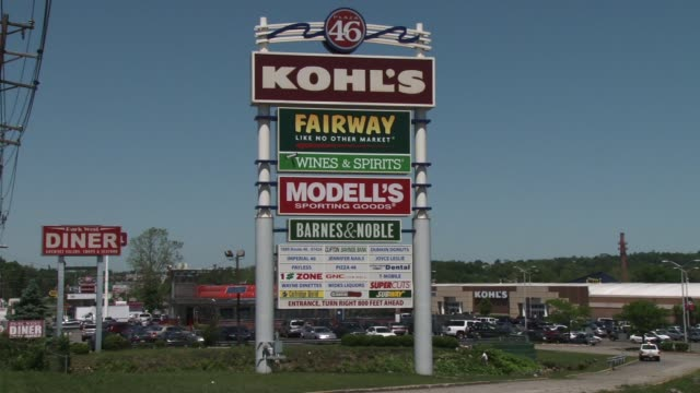 ws and ms of roadside sign in suburban shopping area / cu on sign with shopping plaza in background / stores on sign include kohl's fairway modell's... - kohls stock videos & royalty-free footage
