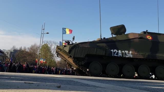 and romanian service members participate in romania's national day parade at bucharest, romania, dec 1, 2018. - basco video stock e b–roll