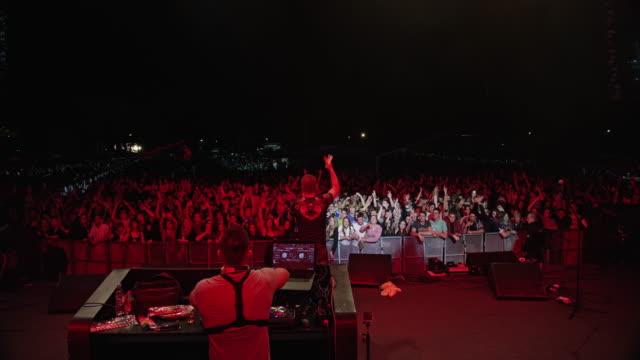 DJ and singer uplifting audience