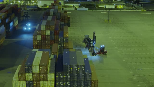 utr and top handler arranging containers in shipping yard - container stock videos & royalty-free footage