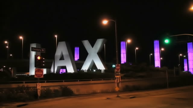 lax and traffic by night, time lapse - lax airport stock videos & royalty-free footage