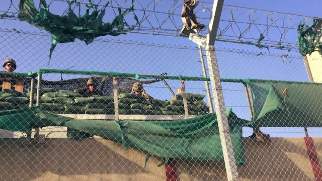 and us forces guard the perimeter of kabul airport, as people try to flee country after taliban takeover of afghanistan - north america stock videos & royalty-free footage