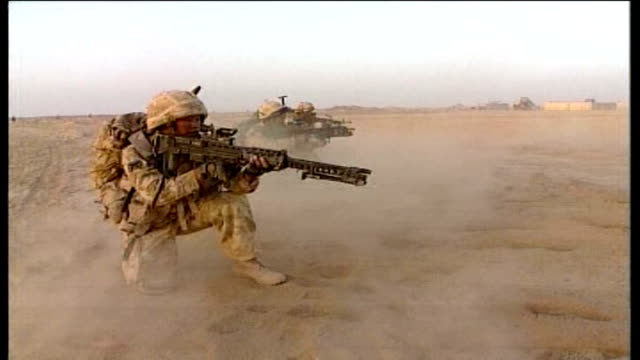 and us forces left exposed as commanders appeal for help; afghanistan: ext armed british troops on exercise in desert - afghanistan stock-videos und b-roll-filmmaterial