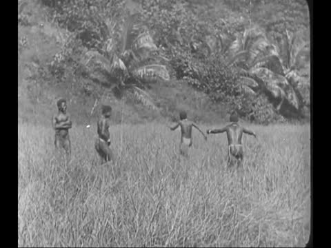 andamanese men with primitive weapon/ white man standing among pygmy people comparing their height/ andaman native having a conversation/ indigenous... - sporting term stock videos & royalty-free footage