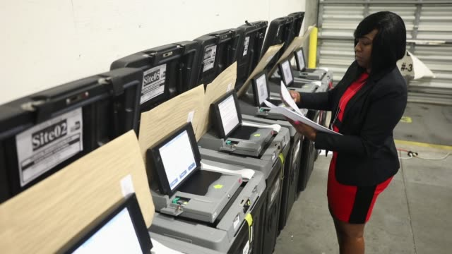 andcherla marcelin a miamidade election support specialist checks voting machines for accuracy at the miamidade election department headquarters on... - miami dade county stock videos and b-roll footage