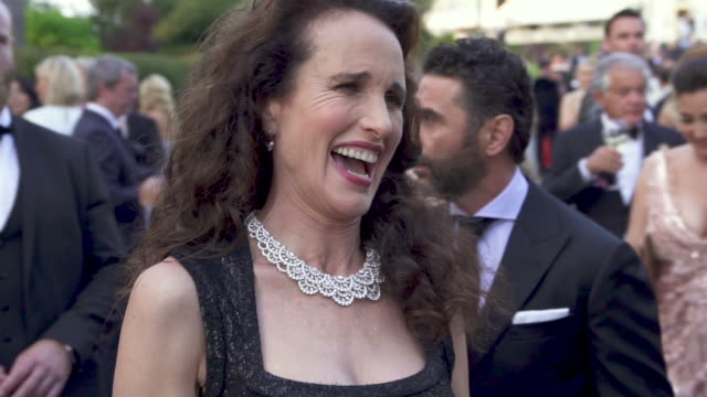 SLOMO Andie MacDowell at amfAR Cannes Gala 2019 Arrivals at Hotel du CapEdenRoc on May 23 2019 in Cap d'Antibes France