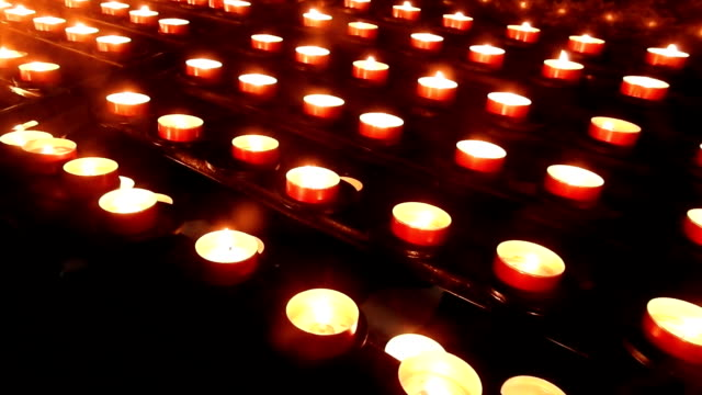 сandles burn in the church - candlelight stock videos & royalty-free footage