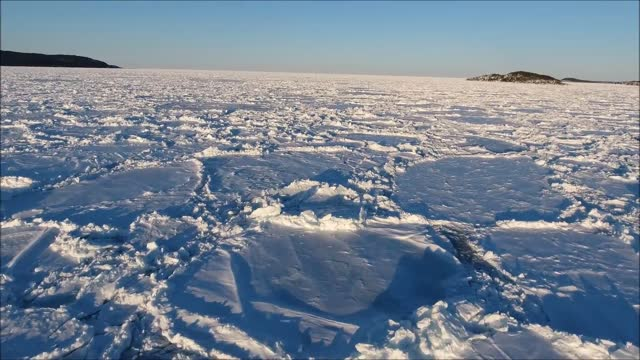 andre beyzaei flew his drone over the sea off newfoundland, canada, on march 27, and captured this stunning close-up footage of ice across the north... - north atlantic ocean stock videos & royalty-free footage