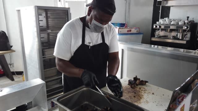 andre scott prepares a lunch dish at his sparky's jerk bbq cuisine restaurant in wynwood on july 09 2020 in miami florida the restaurant has an... - miami dade county stock videos & royalty-free footage