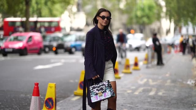 andreea cristea wears a blue coat, a blue mesh shirt with colored features, a green skirt, blue pvc boots, a bag during london fashion week september... - mesh textile stock videos & royalty-free footage