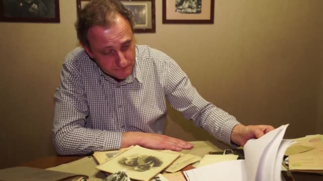 andrei kolesnikov lays out the letters his grandfather sent home from the stalinist labour camp where he eventually died after eight years as a... - political prisoner stock videos & royalty-free footage