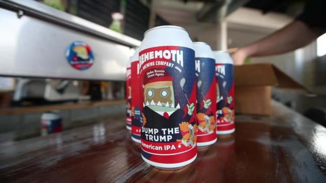 andrew childs of behemoth brewing company arranges the cans of dump the trump american pale ale on september 11, 2020 in auckland, new zealand.... - new zealand culture stock videos & royalty-free footage