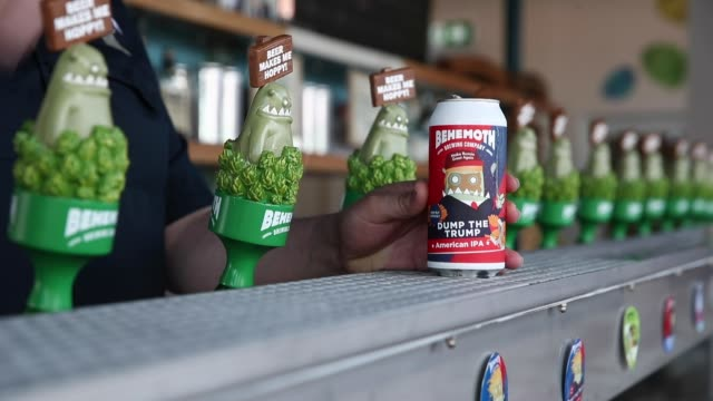 andrew childs of behemoth brewing company opens a can of dump the trump american pale ale on september 11, 2020 in auckland, new zealand. behemoth... - new zealand culture stock videos & royalty-free footage