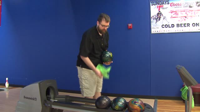 andrew cowen is practicing to bowl a perfect 300 game while bowling backwards at globowl fun center on april 15 2014 in marengo il - ボーリングボール点の映像素材/bロール