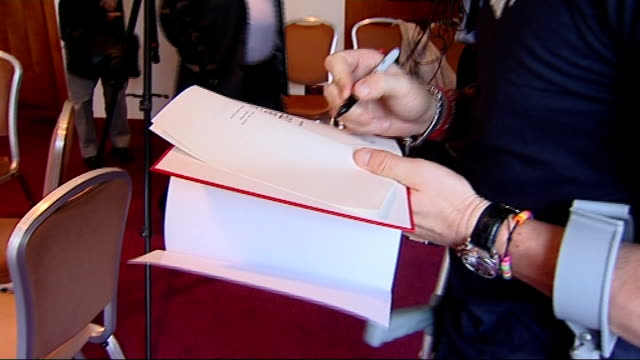 andrew flintoff along on crutches flintoff autographing copy of his book flintoff greeting itn reporter sot andrew flintoff interview sot i will be... - autographing stock videos and b-roll footage