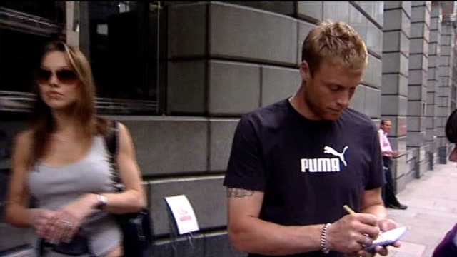 andrew flintoff retires from all cricket; date unknown england: flintoff signing autograph next to his wife rachel flintoff - wife stock videos & royalty-free footage