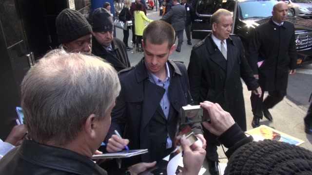 andrew garfield exits the good morning america show signs for poses with fans in celebrity sightings in new york - good morning america stock videos and b-roll footage