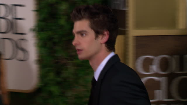 andrew garfield posing for paparazzi and moving along the red carpet at the beverly hilton hotel - the beverly hilton hotel stock videos & royalty-free footage