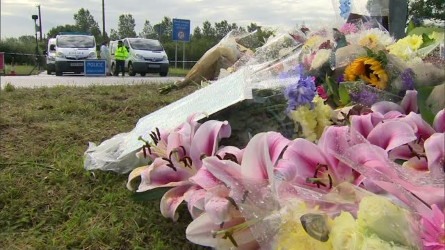 Further tributes paid as police continue to question 10 people ENGLAND Berkshire Sulhamstead EXT Floral tributes flowers at roadside in memory of PC...