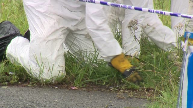 Further tributes paid as police continue to question 10 people ENGLAND Berkshire Sulhamstead EXT Various of police forensic officers on hands and...
