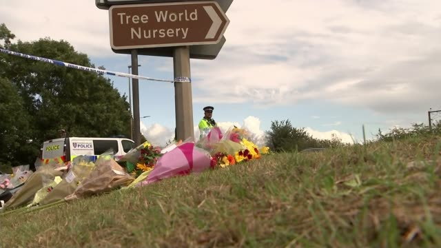 Police charge man with murder as nine suspects released on bail ENGLAND Berkshire Sulhamstead EXT Floral tributes left near where PC Andrew Harper...