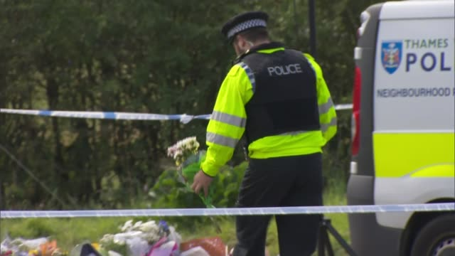 Police given more time to question ten suspects ENGLAND Berkshire Sulhamstead EXT Close shot of floral tributes for PC Andrew Harper Police officer...
