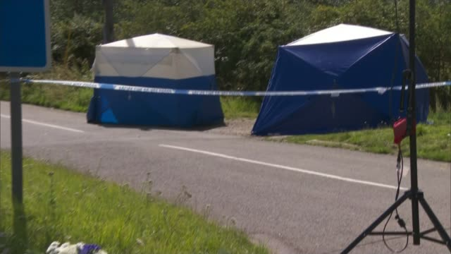 Police given more time to question ten suspects ENGLAND Berkshire EXT Forensic tents at scene of murder Floral tribute left to PC Andrew Harper