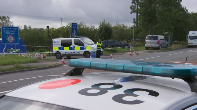 Police given more time to question ten suspects ENGLAND Berkshire EXT Traffic along past police blockade of lane where PC Andrew Harper was murdered...