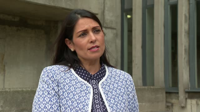 andrew harper murder: priti patel interview; england: london: lambeth: metropolitan police central communications command centre: ext priti patel mp... - crime and murder点の映像素材/bロール