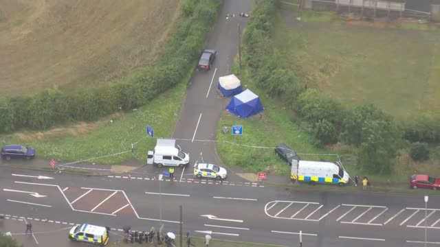Ten people arrested ENGLAND Berkshire Sulhamstead Police vehicles officers and forensics tents at the scene of the death of PC Andrew Harper