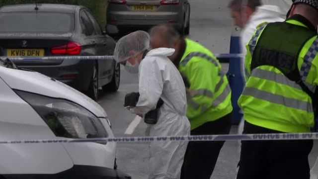 Ten people arrested ENGLAND Berkshire Sulhamstead EXT Police officers and forensics officers in the lane where PC Andrew Harper died