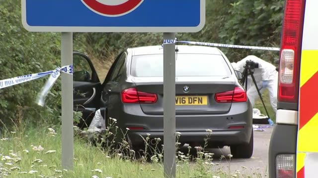 Ten people arrested ENGLAND Berkshire Sulhamstead EXT Car in road with police forensics officer seen working in road beyond Police forensics officer...