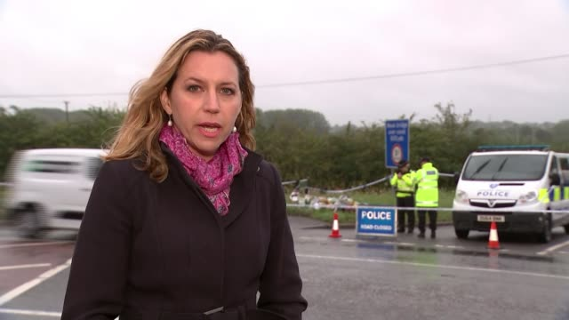 Ten people arrested ENGLAND Berkshire Sulhamstead EXT Reporter to camera SOT Various of Police officers and vehicles at an area where a number of...