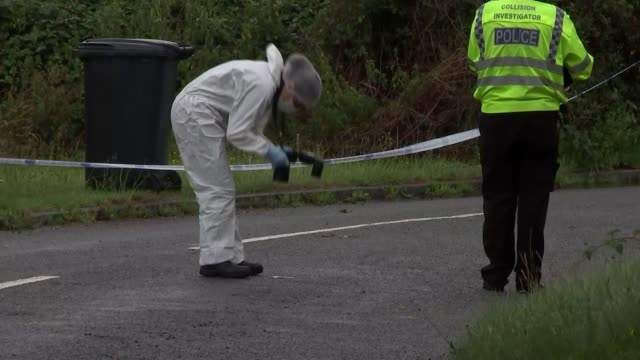 Ten people arrested ENGLAND Berkshire Sulhamstead EXT Police forensics officer taking photograph of item on the road where PC Andrew Harper died...