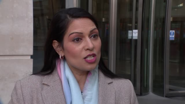 andrew marr show doorstep interviews england london bbc broadcasting house ext priti patel mp interview sot re oxfam scandal - priti patel stock-videos und b-roll-filmmaterial