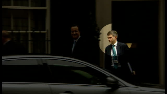 andrew mitchell 'plebgate' inquiry: sir jeremy heywood criticised by mps; downing street: ext david cameron mp leaving number ten followed by chris... - jeremy heywood stock videos & royalty-free footage