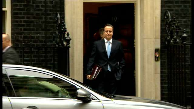 andrew mitchell 'plebgate' inquiry sir jeremy heywood criticised by mps date ext david cameron from number 10 with chris martin behind - jeremy heywood stock videos & royalty-free footage